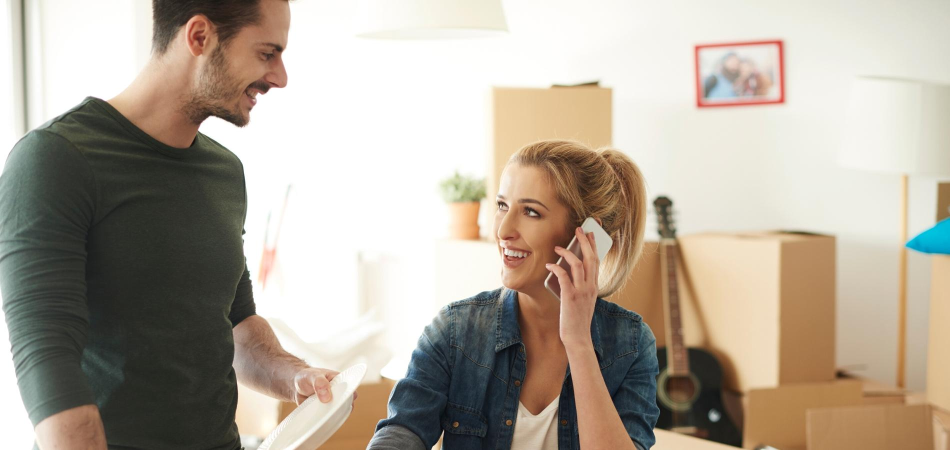 A Couple Asking Realtor Questions About Buying A Home