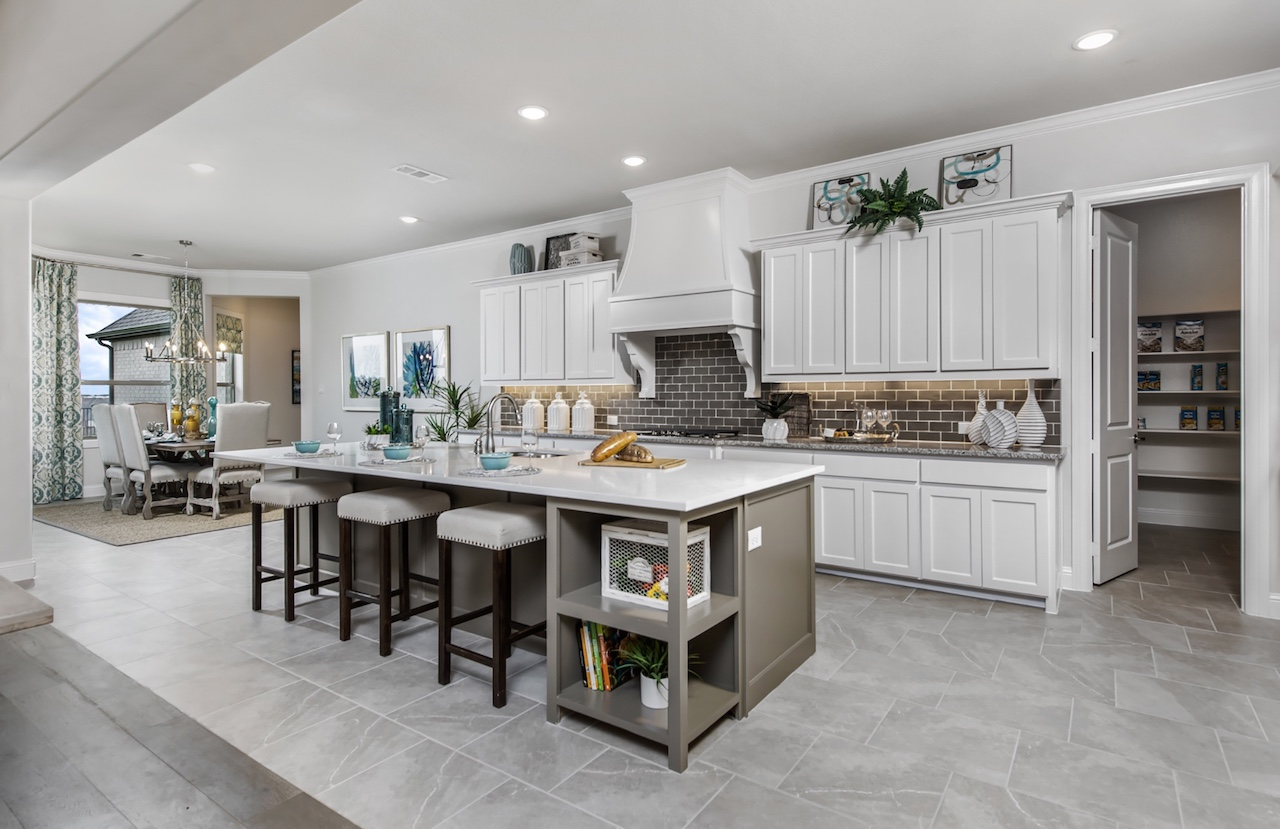 our country homes - falls of prosper - kitchen
