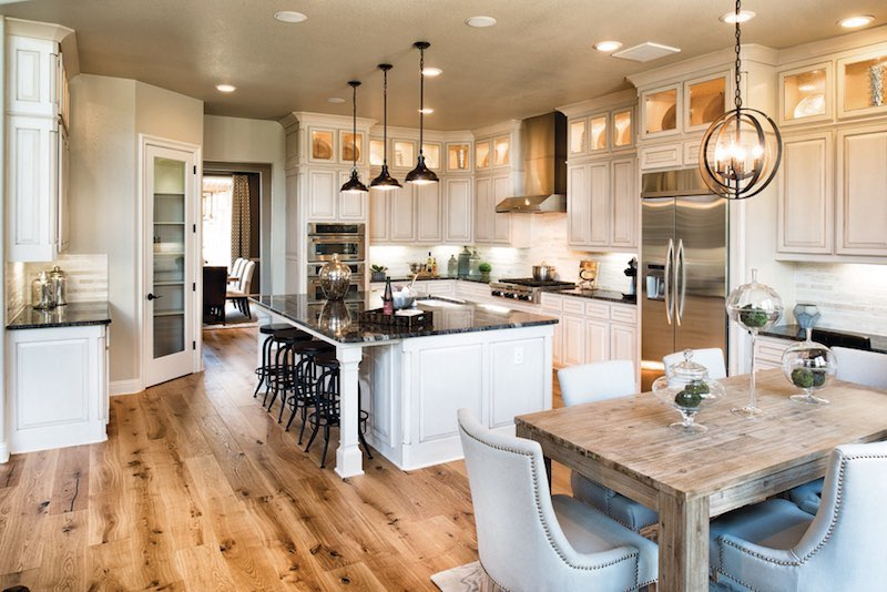 The kitchen in the Toll Brothers Model at Star Trail Prosper Tx
