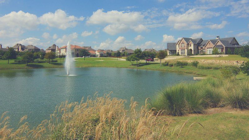 a pond at whitley place in prosper tx