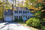 An example of a home for sale in Brandermill, two story, one car garage, with a light blue door.