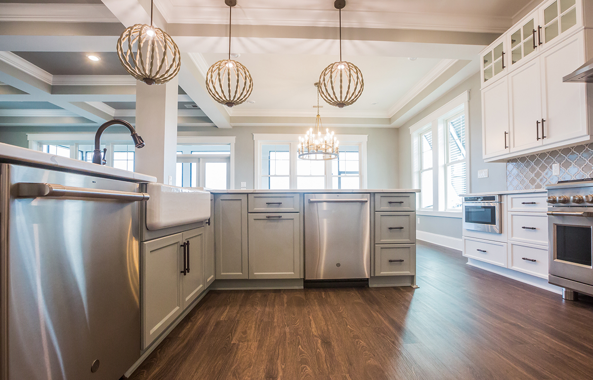 Open concept kitchen with chandeliers