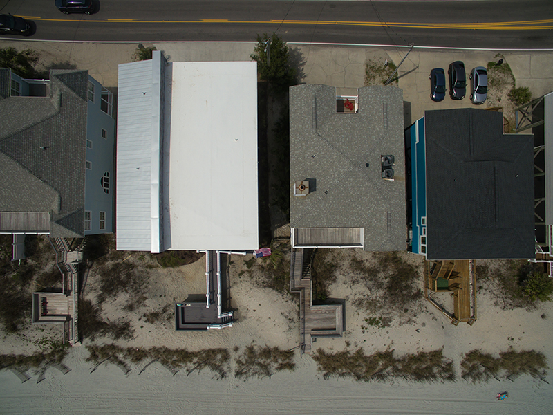 Aerial view of modern Garden City oceanfront home